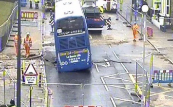 PICTURES: Sinkhole appears in Lewisham, bus begins sinking into road