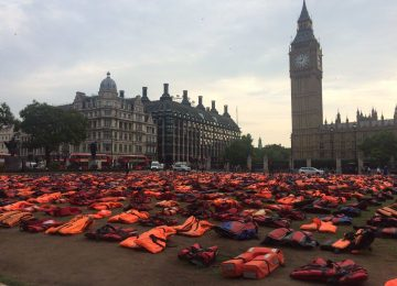 The plight of refugees has been highlighted in a striking display outside Parliament