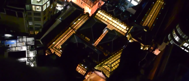This daredevil climbed to the top of the Lloyds Building and sat on the edge